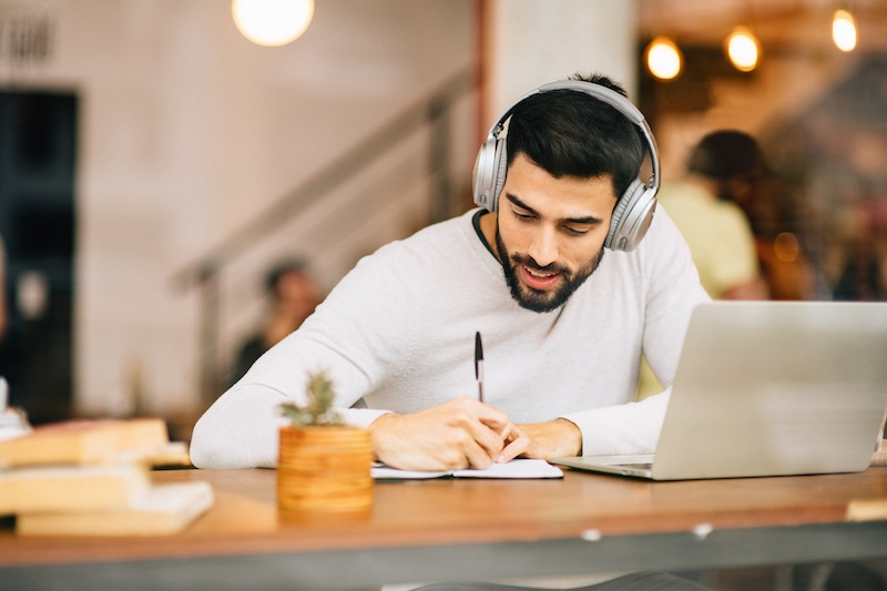 Student working with Laptop in Coffee Shop